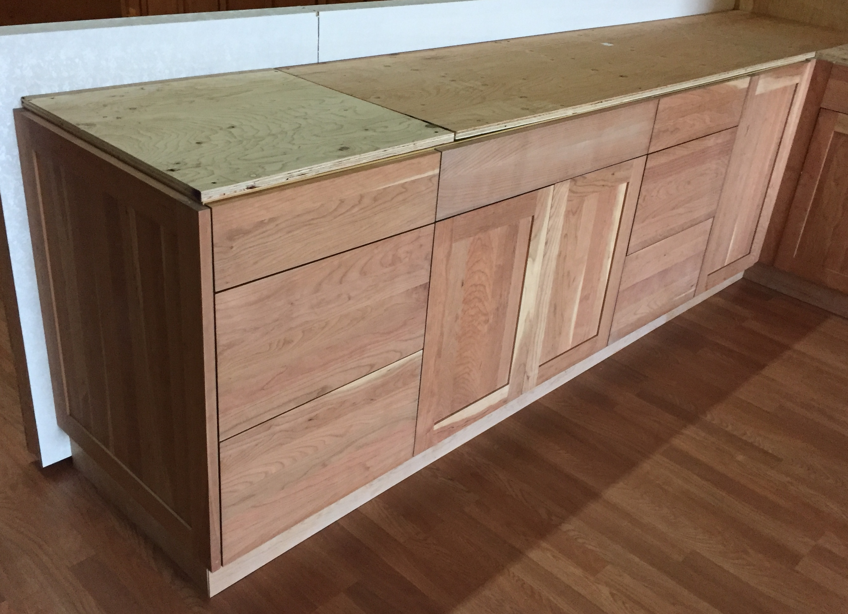 Unfinished natural american cherry shaker kitchen cabinets for Kitchen shelves and cupboards