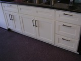 Cream colored Beech Shaker Kitchen Cabinets gallery image