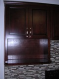 Walnut Colored Maple Flat Panel Kitchen Cabinets gallery image