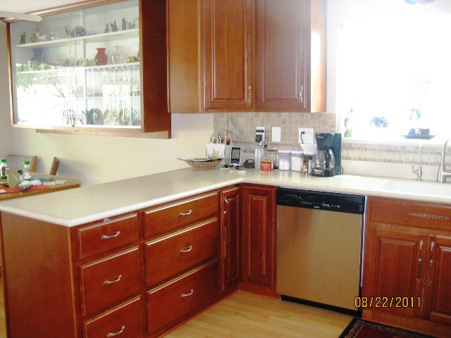 Natural cherry arched door kitchen cabinets photo album for Arch kitchen cabinets
