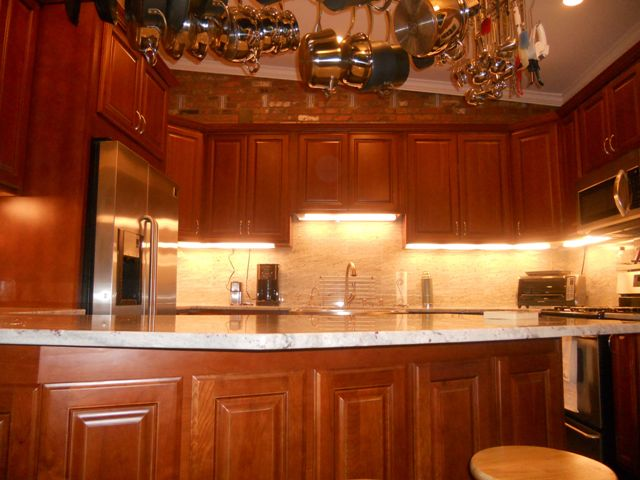 Natural cherry arched door kitchen cabinets photo album for Arched kitchen cabinets